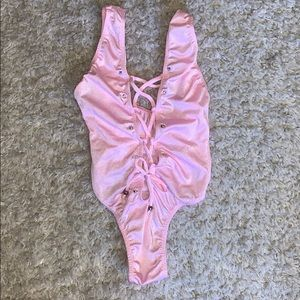 Pink body suit